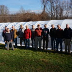 2015 Fall crew covering hoop house.