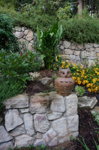 Weeds think twice before invading Ralph Lambert's garden with the well place Owl guardian watching.