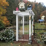 Stunning garden feature with bird houses mark the entrance to Don Ziermann and Ed Smith's vegetable garden